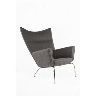 The Hoffman Upholstered/ Stainless Steel Lounge Chair