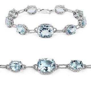 Malaika Sterling Silver 24 3/4ct TGW Blue Topaz Tennis Bracelet