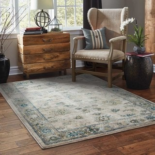Faded Traditional Ivory/ Blue Rug (6'7 x 9'6)