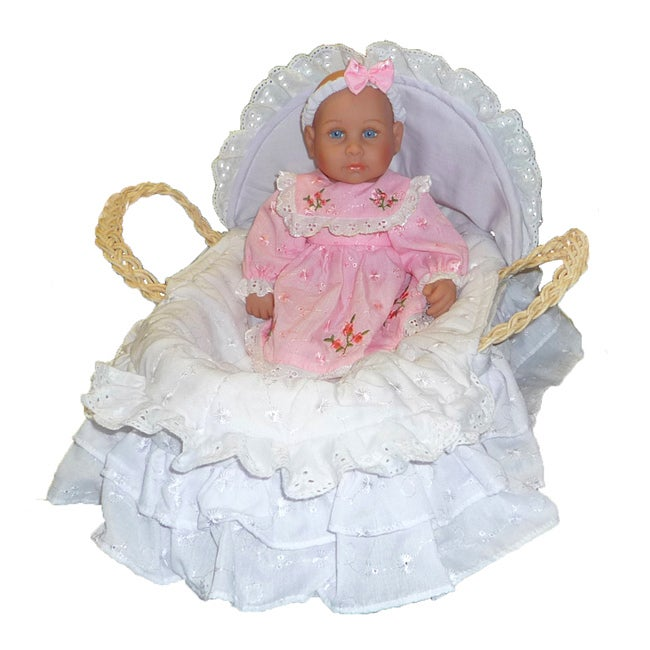 Bellini Baby in Pink Eyelit Dress and Corn Husk Basket