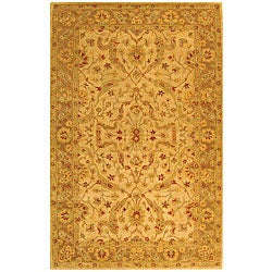 Handmade Antiquities Treasure Ivory/ Brown Wool Rug (5' x 8')