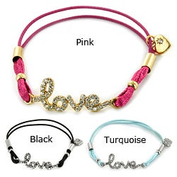 West Coast Jewelry Goldtone/ Silvertone Clear Crystal 'Love' Colored Stretch Cord Bracelet