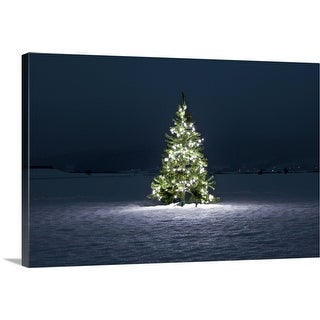 """Illuminated Christmas tree on the snow at night"" Canvas Wall Art"