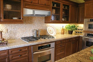 Kitchen with a stainless steel range hood