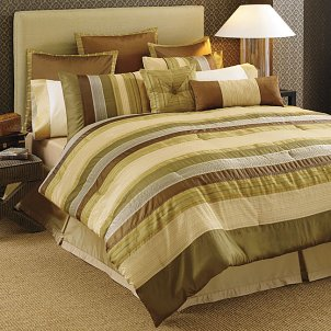 A bedroom comforter set in pleasant earth tones