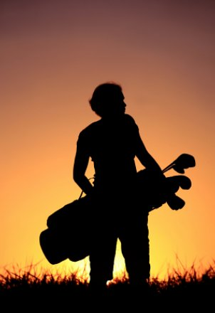 Silhouette of woman with golf bag