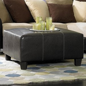 Square leather ottoman in a living room