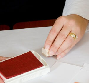 Woman using a rubber stamp