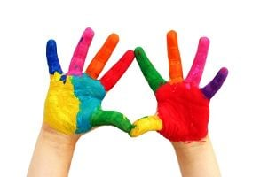 Kid's hands covered in finger paint