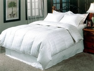White down comforter on a queen size bed