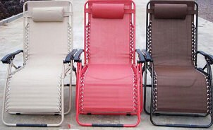 White, red and brown vinyl lawn chairs