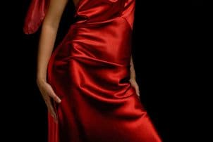 Woman in red satin dress