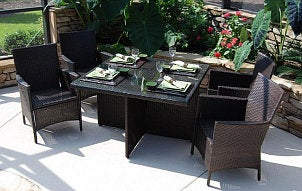 Wicker patio table set for four with matching chairs