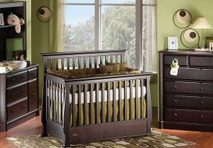 Dark brown crib in nursery furniture set