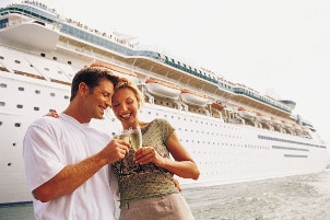 Couple toasting to their cruise
