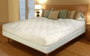 Bed with pillow-top mattress