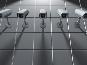 Security cameras mounted on a wall