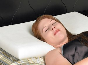 Woman sleeping with memory foam pillow