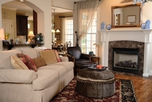 Open family room with sofa, chair and ottoman