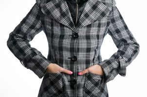 Woman wearing a plaid coat