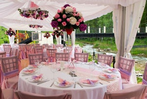 Wedding tables decorated for outdoor reception