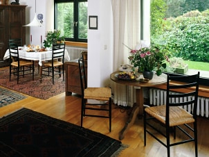 Open floor plan with dining table and breakfast table