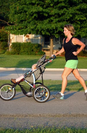 Woman running with a jogging stroller
