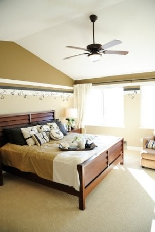 Lighted ceiling fan cools bedroom