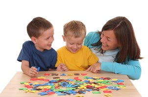 Kids and mom playing with a puzzle
