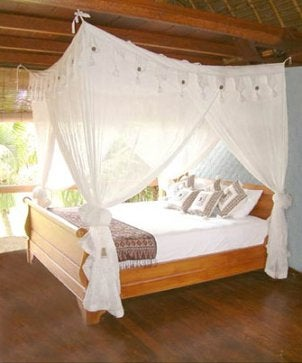Queen bed with a white canopy