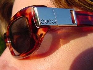 Woman wearing attractive Gucci sunglasses