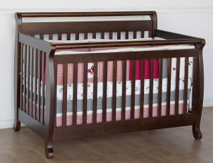 Wooden baby crib with bedding