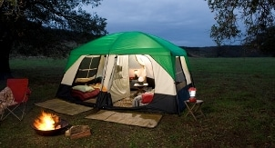 An inviting camping scene created in a meadow with the best camping gear