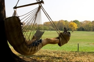 Man relaxing in a hammock chair