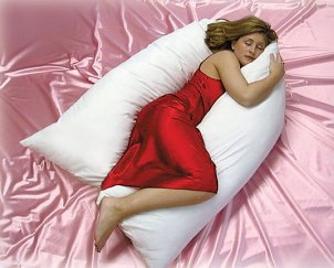 Woman laying on a body pillow