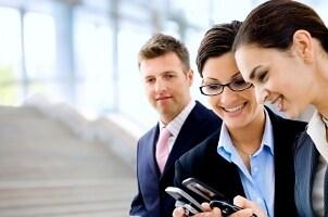 Business associates using a cell phone