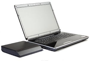 Laptop plugged into an external hard drive