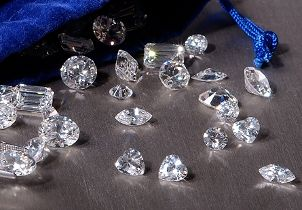Scattered loose diamonds of varying shapes
