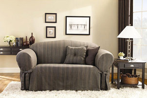 Sofa with grey fitted slipcover dresses up living room