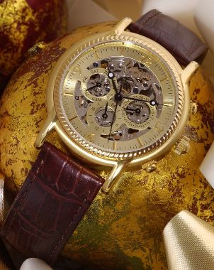 Gold Bulova watch with a leather watchband