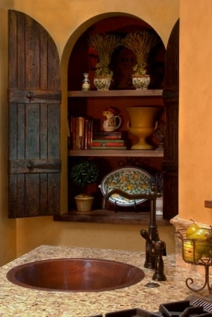 Copper sink in a rustic kitchen