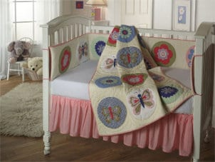 Baby nursery filled with cute baby furniture