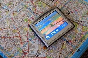 GPS device sitting on a paper map
