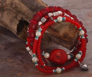 A pretty red beaded charm bracelet