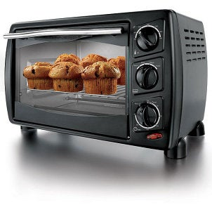 Black toaster oven with muffins baking inside
