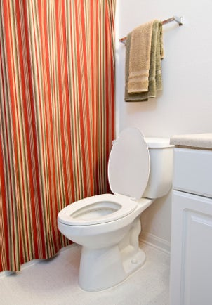 Simple bathroom with a white toilet
