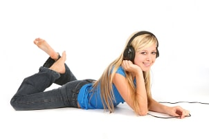 Woman listening to a custom playlist on her MP3 player