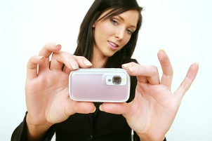 Girl setting up a point and shoot camera