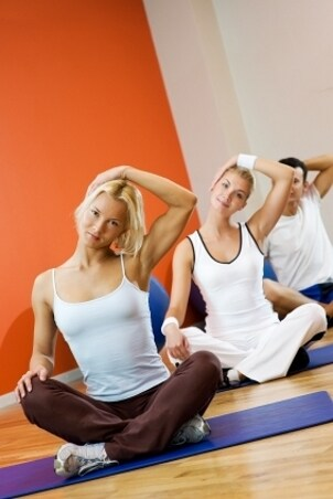 Yoga practitioners sitting on yoga mats