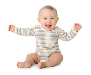 Happy baby with arms raised